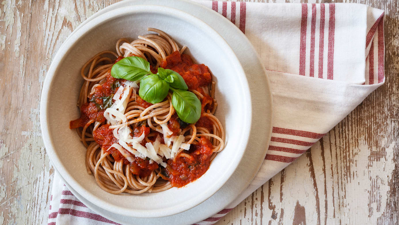 Bowl, Fork, no people, food and drink, Sauce, Tomato Sauce, Noodle, Pasta, Spaghetti, Freshness, indoor, studio shot, elevated view, wood, healthy eating, Cheese, parmesan, whole meal, spice, herbs, basil, kitchen towel, Spelt, Italian Food, spicy, Food and Drink, spelt pasta, Whole grain spaghetti