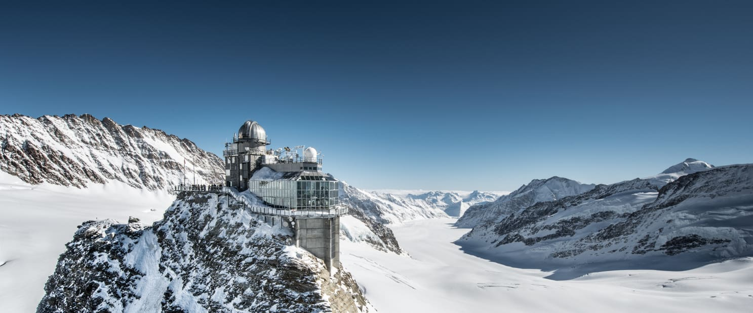 Building on top of mountain over looking glacier, snow and distant mountains