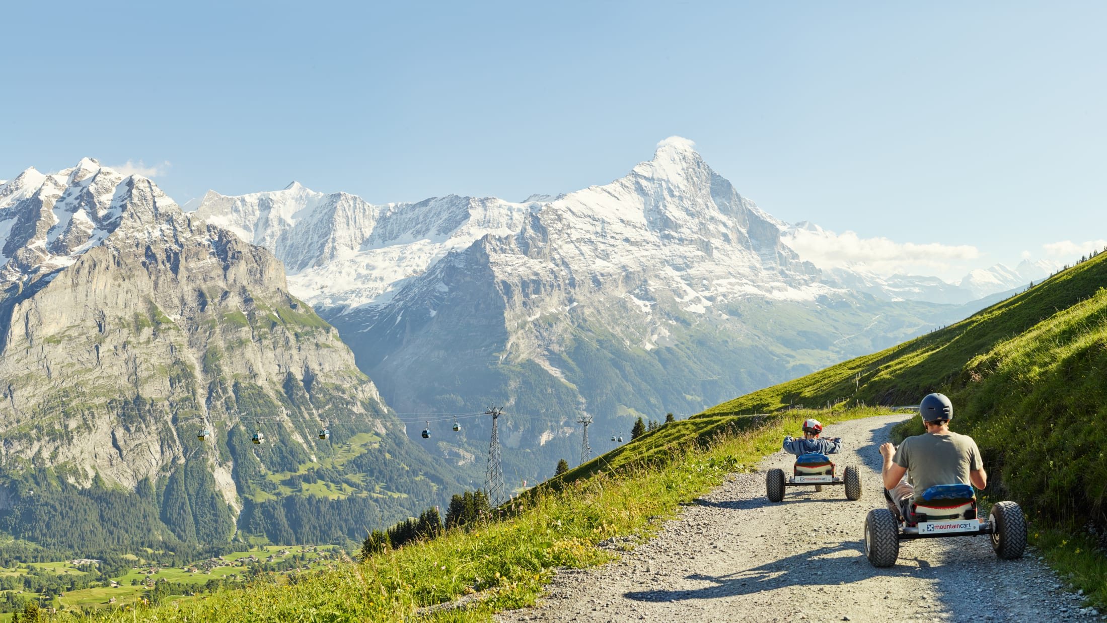 [Translate to English:] First Mountaincart Panorama Eiger Wetterhorn Grindelwald